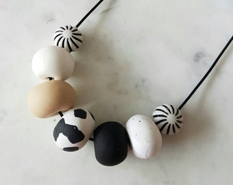 Black, tan and white clay bead necklace