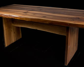 Large walnut dining table,Heavy duty,Built like a tank,will last forever.