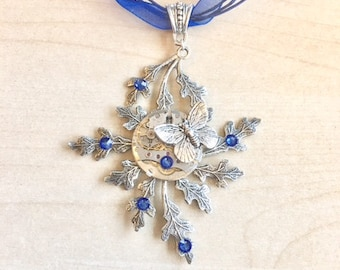 Necklace in silver plated and blue Swarovski Crystal, with real watch mechanism and Butterfly