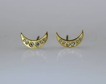 Crescent moon and diamond stud earrings