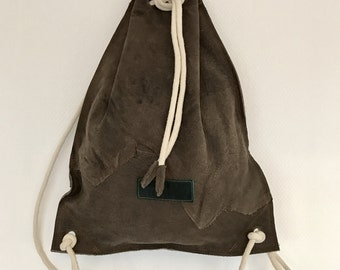 Dark brown leather drawstring backpack, raw edge leather backpack