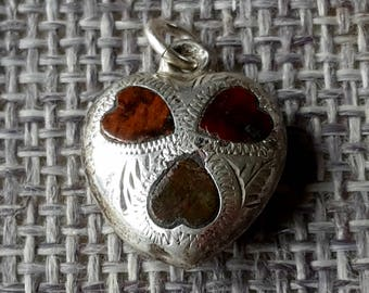 This is a sunning Victorian antique Scottish solid silver and agate heart pendent charm