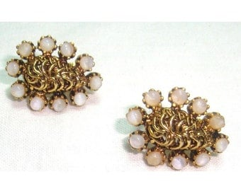 """Elegant gold tone clip on earrings with milk glass colored stones.  Vintage classic style. About 1"""" ling in good used condition"""