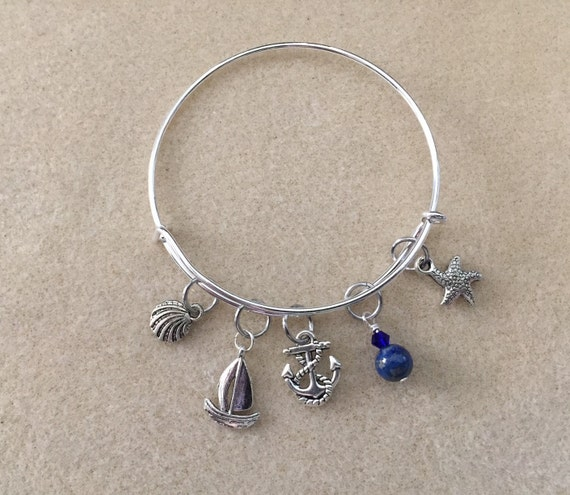 Adjustable Wire Bangle Charm Bracelet with Beach, Boat, Water Theme and Lapis Lazuli Gemstone Bead with Crystal. Sailboat, Sea Shell, Anchor