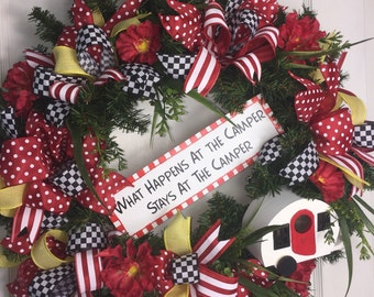 What happens at the camper, Stays at the camper! Door Wreath