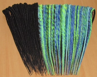 synthetic dreads, burning man, black double ended dreadlocks with electric blue, sky blue, UV Yellow dreads with colour are harlequin