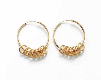 Hoop earrings with small circles