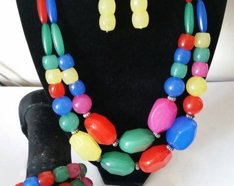 A women chunky multi colour beaded layered bib necklace earring and bracelet set