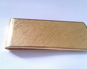 gold coloured money note clip