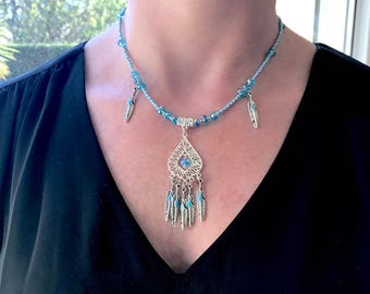 Necklace turquoise blue and silver with feathers and Crystal Charms