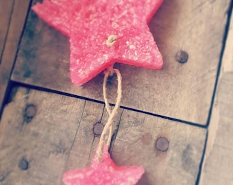 Hanging star. This pink is leather.