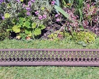 Antique cast iron curb fireplace fender