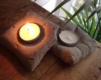 Concrete candle cushions