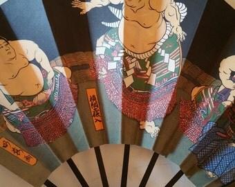Sumo wrestler Asian paper fan