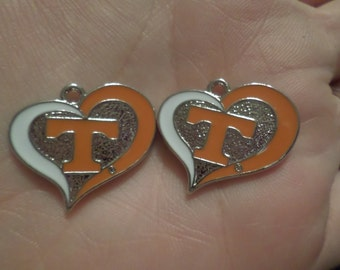 Set of 2 University Of Tennessee Heart charms.