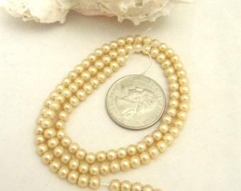 Strand of 4 mm Glass Pearls - Pale Gold (1956)