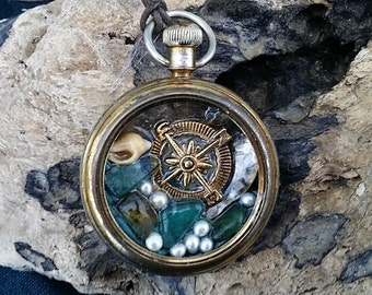 Beachtreasury pendant : an ocean in a vintage pocket watchcase, Little windrose,resin, seaglass & shells from Quiberon beach, pearls