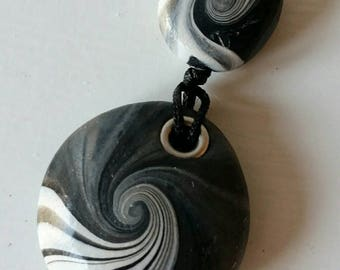 Grey swirl polymer clay pendant and matching bead.