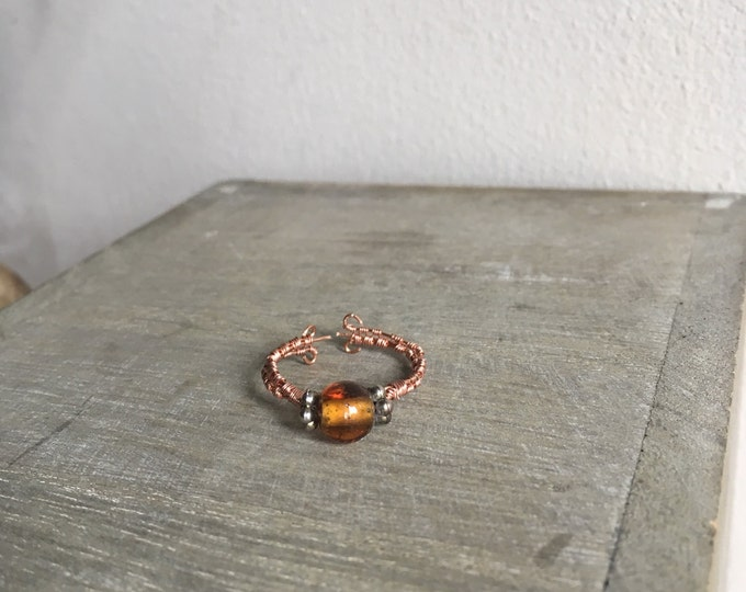 Bohemian Copper Ring With Flower Beads and a Shiny Brown Bead