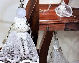 Pendant on a chain - a mini doll
