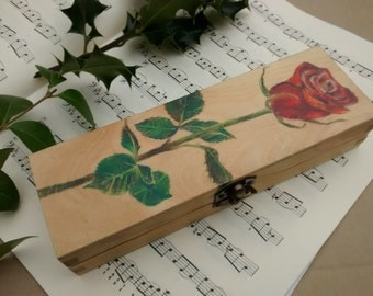 Red rose hand drawn on wooden box