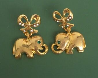 Elephant On Bow Dangle Earrings .