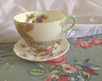 Vintage bone china mismatched Shelley heather teacup and Spode saucer