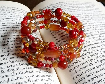 Tubular bracelet in shades of red and gold, with crystals | Rigid red and gold bracelet with crystals and stones
