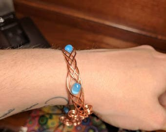 Copper and Blue Glass Cat's Eye Bead