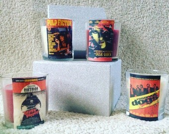 Set of four Quentin Tarantino fim posters hand decorated scented candles Pulp Fiction, Reservoir Dogs, Deathproof and From Dusk 'til Dawn