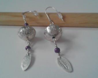 Decorative silver bead dangle earrings.