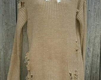 Large distressed over-sized cable knit sweater