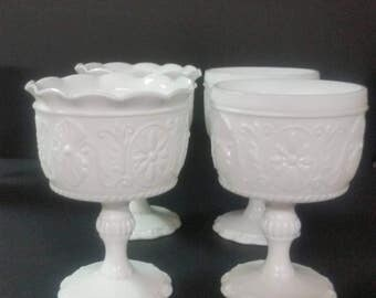 Vintage set of 2 milk glass pedestal candy, nut dishes.  Candle Holders. Scroll design. Buyers choice.