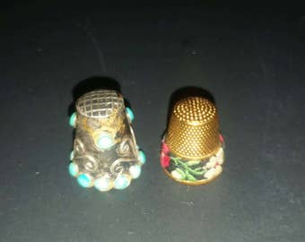 A pair of vintage thimbles. One turquoise and one embroidery floral design