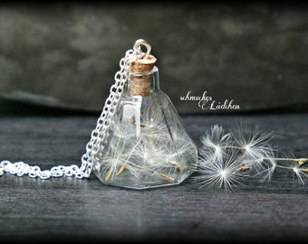 silver-plated glass vials necklace with flower seeds