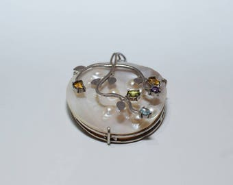 Beautiful pendant with mother of Pearl Topaz Amethyst Peridot citrine celeste