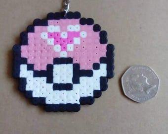 Pink heart pokeball keyring