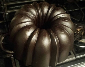 German Bundt pan, Cast iron. Missing one handle.