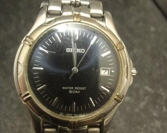 Vintage SEIKO 7N32-0120 blue face quartz with date aperture