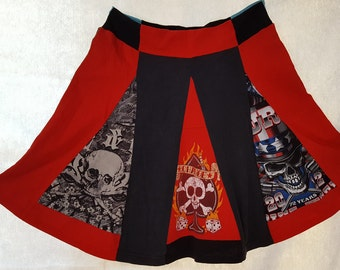 T-skirt: Be the life of the party in this skirt made from previously owned t-shirts. Skulls/skeletons. One size fits most. Soft and flirty!