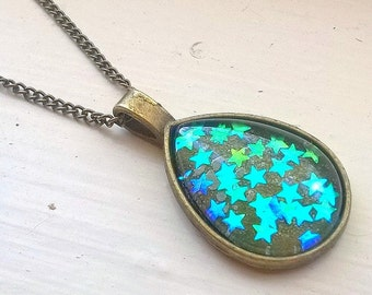 Stars pendant necklace... antiqued brass glass dome teal shimmery stars... adjustable chain ...great gift for a girl woman