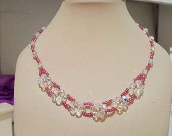 Fuchsia Beaded Necklace. Made of fuchsia japanese miyuki beads, and 6 mm clear glass crystal beads.