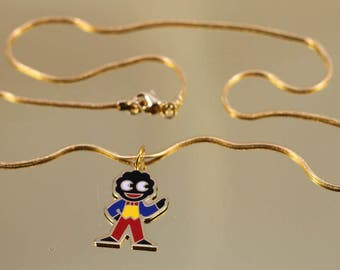 1980s Robertson's golly promotional pendant necklace.
