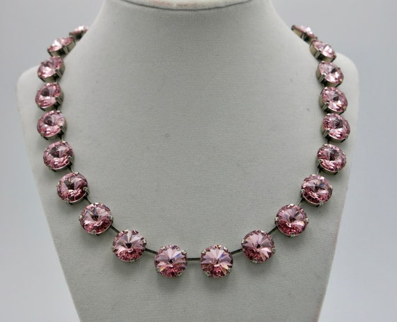 Make a statement on your wedding day or any other occasion with this eye catching light rose pink Swarovski® crystal collar necklace.