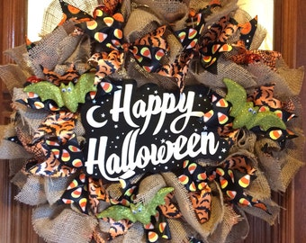 Old Scool Happy Halloween Wreath with all the Halloween favorites: candy corns, bats have googly eyes, spiders,  pumpkins!