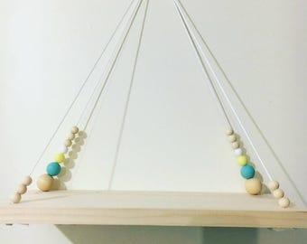 Swing for nursery shelf