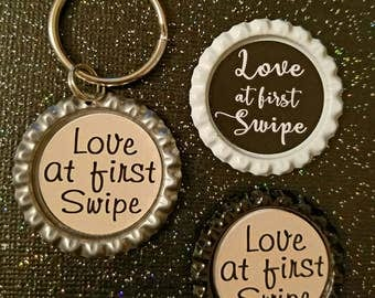 Love at first swipe keychain & magnets