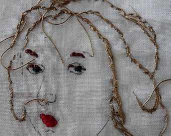 Sideways glance lady embroidered drawing