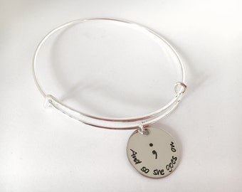 And so she goes on personalized bangle bracelet my story isn't over yet semicolon jewelry suicide prevention suicide awareness semi colon