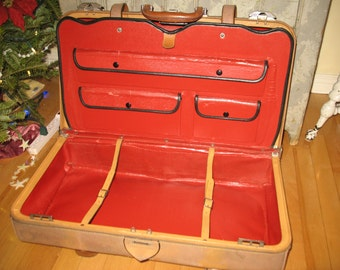 Vintage suitcase with red compartment. Brand traveler.